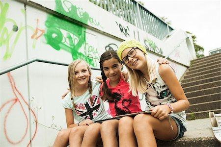preteen girl pigtails - Girls Sitting on Steps with Tablet Computers, Mannheim, Baden-Wurttemberg, Germany Stock Photo - Premium Royalty-Free, Code: 600-07117287