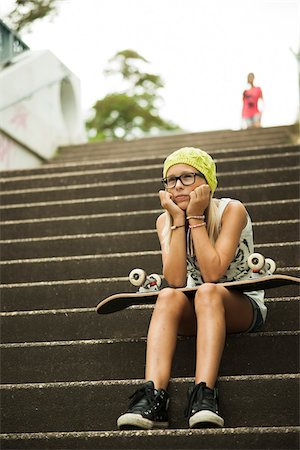 Girl Sitting on Steps with Skateboard, Mannheim, Baden-Wurttemberg, Germany Stock Photo - Premium Royalty-Free, Code: 600-07117280