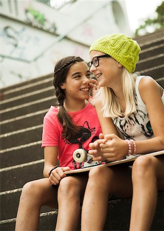 Girls Sitting on Steps with Skateboard, Mannheim, Baden-Wurttemberg, Germany Stock Photo - Premium Royalty-Free, Code: 600-07117281