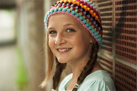 preteen  smile  one  alone - Close-up of Girl Outdoors, Mannheim, Baden-Wurttemberg, Germany Stock Photo - Premium Royalty-Free, Code: 600-07117290