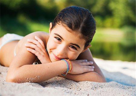 Portrait of Girl at Beach, Lampertheim, Hesse, Germany Stock Photo - Premium Royalty-Free, Code: 600-07117292