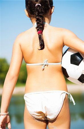 Back View of Girl with Soccer Ball, Lampertheim, Hesse, Germany Stock Photo - Premium Royalty-Free, Code: 600-07117293