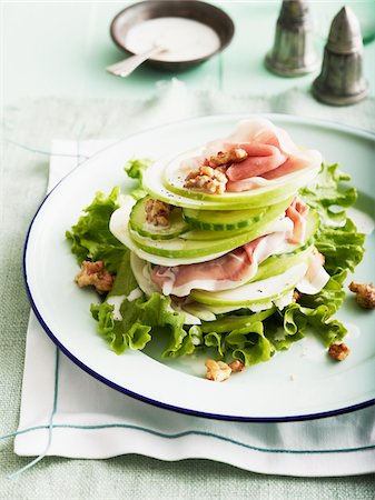 food - Plate of Apple and Fennel Salad with Prosciutto and Walnuts, Studio Shot Stock Photo - Premium Royalty-Free, Code: 600-07110418