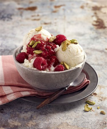 sweets - Bowl of Ice Cream with Raspberries and Pistachio Nuts, Studio Shot Stock Photo - Premium Royalty-Free, Code: 600-07110434