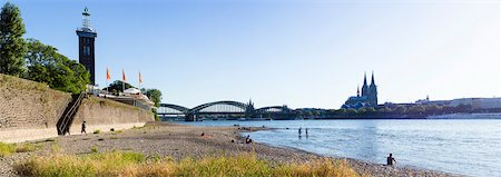 Gravel Shore of River Rhine with Messeturm Koln, Hohenzollern Bridge and Cologne Cathedral in the background, Cologne, North Rhine-Westphalia, Germany Stock Photo - Premium Royalty-Free, Code: 600-07110534