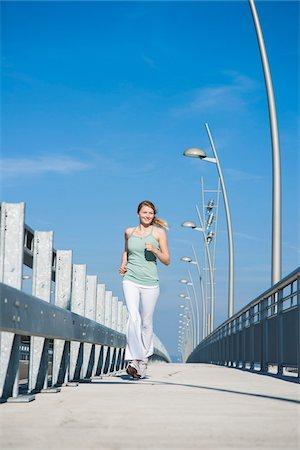Young Woman Running, Worms, Rhineland-Palatinate, Germany Stock Photo - Premium Royalty-Free, Code: 600-07110555