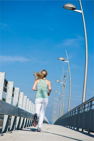 Young Woman Running, Worms, Rhineland-Palatinate, Germany Stock Photo - Premium Royalty-Free, Code: 600-07110556
