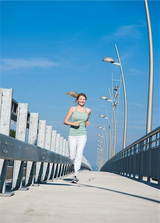 Young Woman Running, Worms, Rhineland-Palatinate, Germany Stock Photo - Premium Royalty-Free, Code: 600-07110557