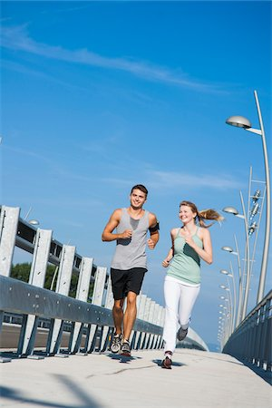 Young Couple Running, Worms, Rhineland-Palatinate, Germany Stock Photo - Premium Royalty-Free, Code: 600-07110558