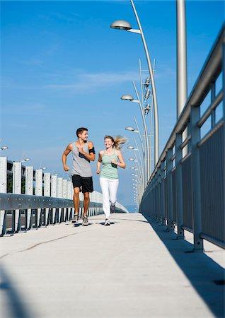 Young Couple Running, Worms, Rhineland-Palatinate, Germany Stock Photo - Premium Royalty-Free, Code: 600-07110559