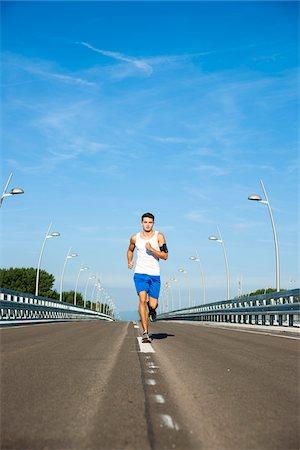 Young Man Running, Worms, Rhineland-Palatinate, Germany Stock Photo - Premium Royalty-Free, Code: 600-07110550