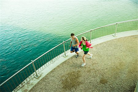 Young Couple Running by Water, Worms, Rhineland-Palatinate, Germany Stock Photo - Premium Royalty-Free, Code: 600-07110579