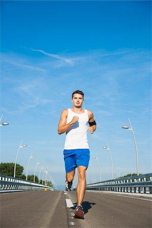 Young Man Running, Worms, Rhineland-Palatinate, Germany Stock Photo - Premium Royalty-Free, Code: 600-07110573
