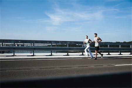 Young Couple Running, Worms, Rhineland-Palatinate, Germany Stock Photo - Premium Royalty-Free, Code: 600-07110584