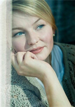 Young Woman Looking out Window, Mannehim, Baden-Wurttemberg, Germany Stock Photo - Premium Royalty-Free, Code: 600-07110655