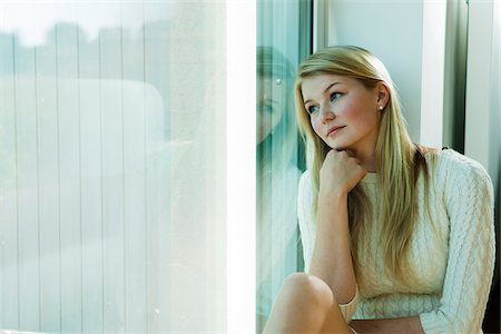Young Woman Looking out Window, Mannehim, Baden-Wurttemberg, Germany Stock Photo - Premium Royalty-Free, Code: 600-07110652