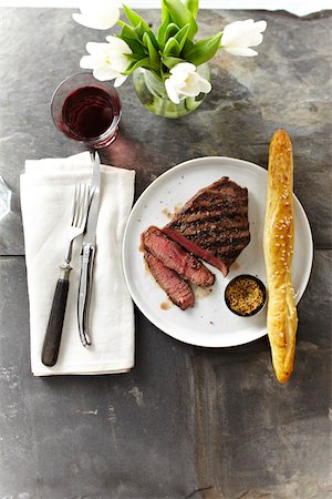 fork - Overhead View of Steak with Spicy Mustard and Breadstick, Studio Shot Stock Photo - Premium Royalty-Free, Code: 600-07110687