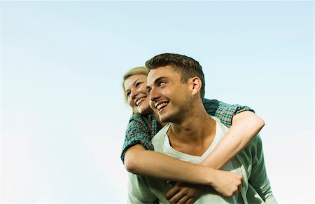 Young Man giving Young Woman Piggyback Ride, Mannheim, Baden-Wurttermberg, Germany Stock Photo - Premium Royalty-Free, Code: 600-07110813