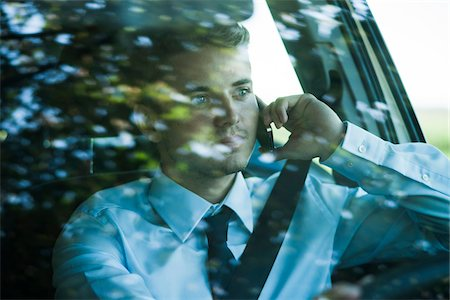 Businessman using Cell Phone and Driving, Mannheim, Baden-Wurttemberg, Germany Stock Photo - Premium Royalty-Free, Code: 600-07110825