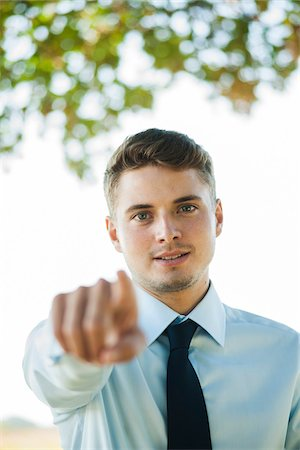 Portrait of Businessman Pointing at Camera, Mannheim, Baden-Wurttemberg, Germany Stock Photo - Premium Royalty-Free, Code: 600-07110832