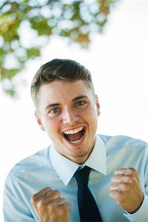 Portrait of Businessman Cheering, Mannheim, Baden-Wurttemberg, Germany Stock Photo - Premium Royalty-Free, Code: 600-07110833