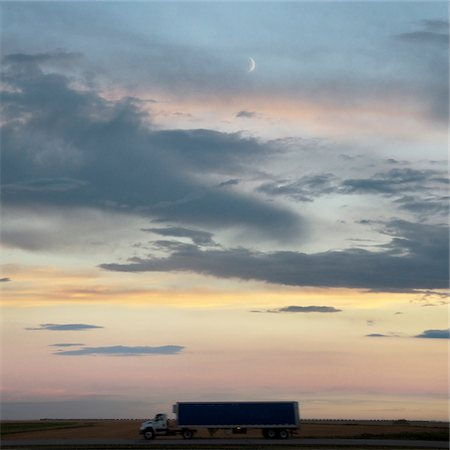 side view tractor trailer truck - Transport truck at dusk on the Trans Canada Highway near Swift Current, Alberta, Canada Stock Photo - Premium Royalty-Free, Code: 600-07122849