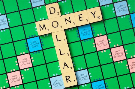 Money and Dollar spelled with Game Tiles Stock Photo - Premium Royalty-Free, Code: 600-07122882