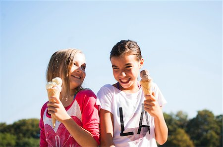 Girls eating Ice Cream Cones, Lampertheim, Hesse, Germany Stock Photo - Premium Royalty-Free, Code: 600-07148085