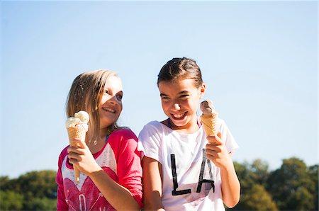 eating ice cream - Girls eating Ice Cream Cones, Lampertheim, Hesse, Germany Stock Photo - Premium Royalty-Free, Code: 600-07148085