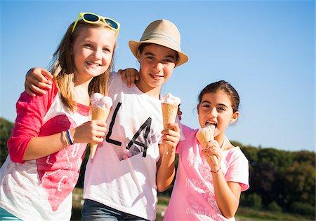 eating ice cream - Girls eating Ice Cream Cones, Lampertheim, Hesse, Germany Stock Photo - Premium Royalty-Free, Code: 600-07148087