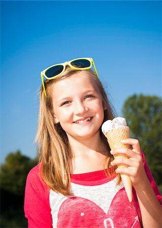 Girl with Ice Cream Cone, Lampertheim, Hesse, Germany Stock Photo - Premium Royalty-Free, Code: 600-07148088
