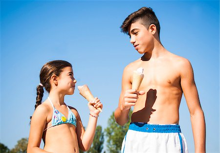 Boy and Girl eating Ice Cream Cones, Lampertheim, Hesse, Germany Stock Photo - Premium Royalty-Free, Code: 600-07148089