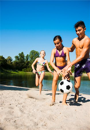 Kids Playing Soccer on Beach by Lake, Lampertheim, Hesse, Germany Stock Photo - Premium Royalty-Free, Code: 600-07148094