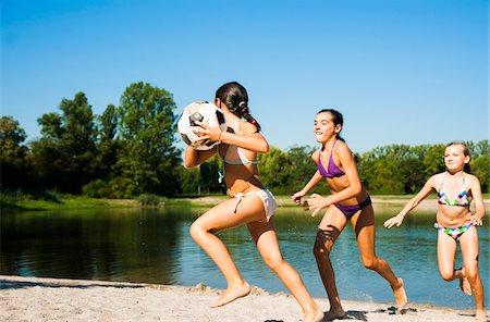 Kids Playing Soccer on Beach by Lake, Lampertheim, Hesse, Germany Stock Photo - Premium Royalty-Free, Code: 600-07148095