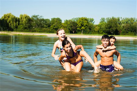 Kids Giving Piggy Back Rides in Lake, Lampertheim, Hesse, Germany Stock Photo - Premium Royalty-Free, Code: 600-07148099