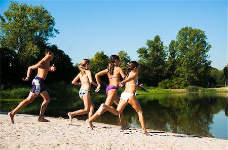 preteen bathing suit - Kids Running on Beach by Lake, Lampertheim, Hesse, Germany Stock Photo - Premium Royalty-Free, Code: 600-07148093