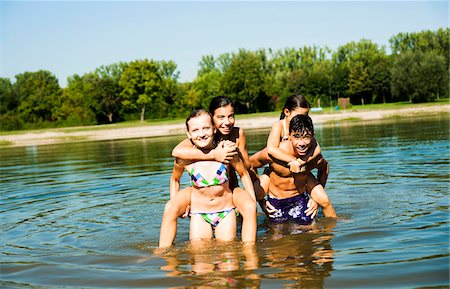 Kids Giving Piggy Back Rides in Lake, Lampertheim, Hesse, Germany Stock Photo - Premium Royalty-Free, Code: 600-07148100