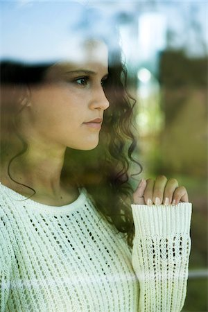 Close-up portrait of teenage girl looking out window, Germany Stock Photo - Premium Royalty-Free, Code: 600-07148144