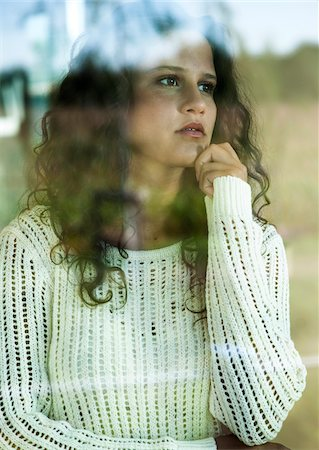 Close-up portrait of teenage girl looking out window, Germany Stock Photo - Premium Royalty-Free, Code: 600-07148143