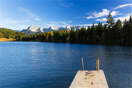 Wooden Dock at Wagenbruchsee with Karwendel Mountains in Autumn, Bavaria, Germany Stock Photo - Premium Royalty-Free, Code: 600-07143693