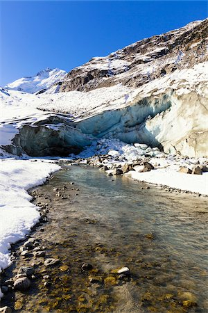snow capped - Morteratsch Glacier and Creek Ova da Morteratsch in first snow in Autumn, Val Morteratsch, Canton of Graubunden, Switzerland Stock Photo - Premium Royalty-Free, Code: 600-07143701
