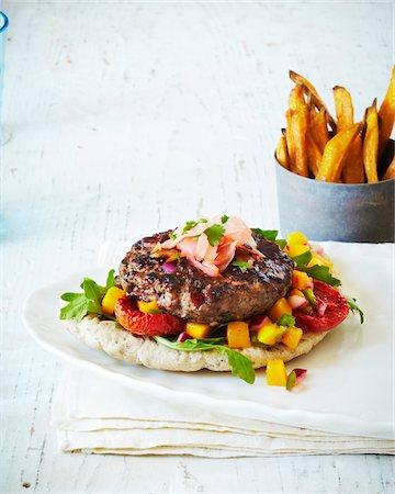 Fresh Burger With Sweet Potato Fries, studio shot Stock Photo - Premium Royalty-Free, Code: 600-07156124