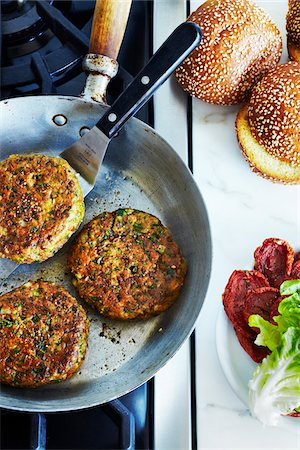 Chickpea falafel burgers in frying pan on stove, studio shot Stock Photo - Premium Royalty-Free, Code: 600-07156123