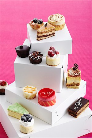 sweets - Variety of pastries and cakes on top of boxes, studio shot Stock Photo - Premium Royalty-Free, Code: 600-07156139