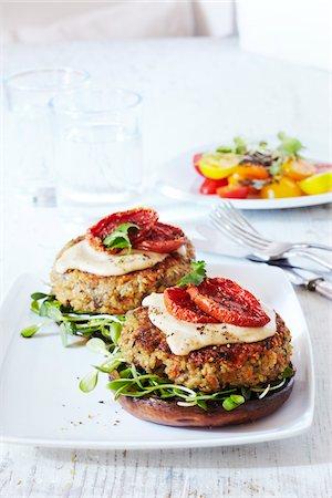 Quinoa veggie burgers on platter, studio shot Stock Photo - Premium Royalty-Free, Code: 600-07156130