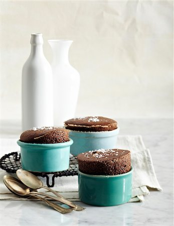 sweets - Dark Chocolate Souffles in ramekins, studio shot Stock Photo - Premium Royalty-Free, Code: 600-07156168