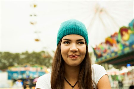 female only - Close-up portrait of teenage girl smiling at amusement park, Germany Stock Photo - Premium Royalty-Free, Code: 600-07156181