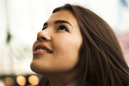 portrait smile caucasian one - Close-up portrait of teenage girl looking upward, Germany Stock Photo - Premium Royalty-Free, Code: 600-07156194