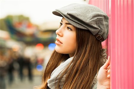 Close-up portrait of teenage girl wearing hat at amusement park, Germany Stock Photo - Premium Royalty-Free, Code: 600-07156190