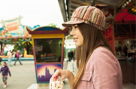 Portrait of Young Woman at Amusement Park, Mannheim, Baden-Wurttemberg, Germany Stock Photo - Premium Royalty-Free, Code: 600-07156259